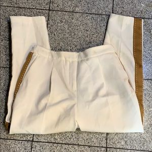 Cream colored tapered elastic pant w/ tan stripe